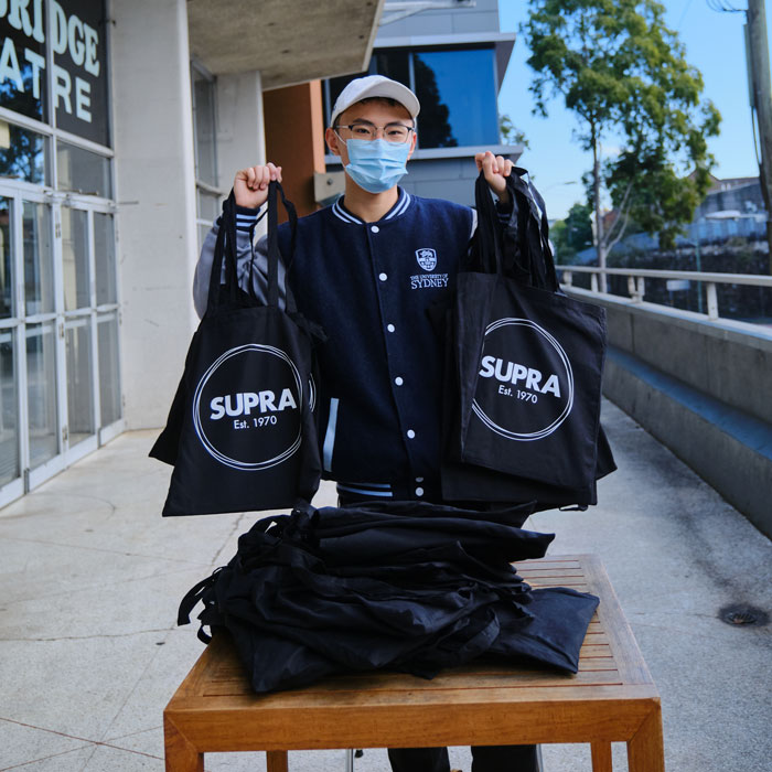 Handing-out-SUPRA-packs