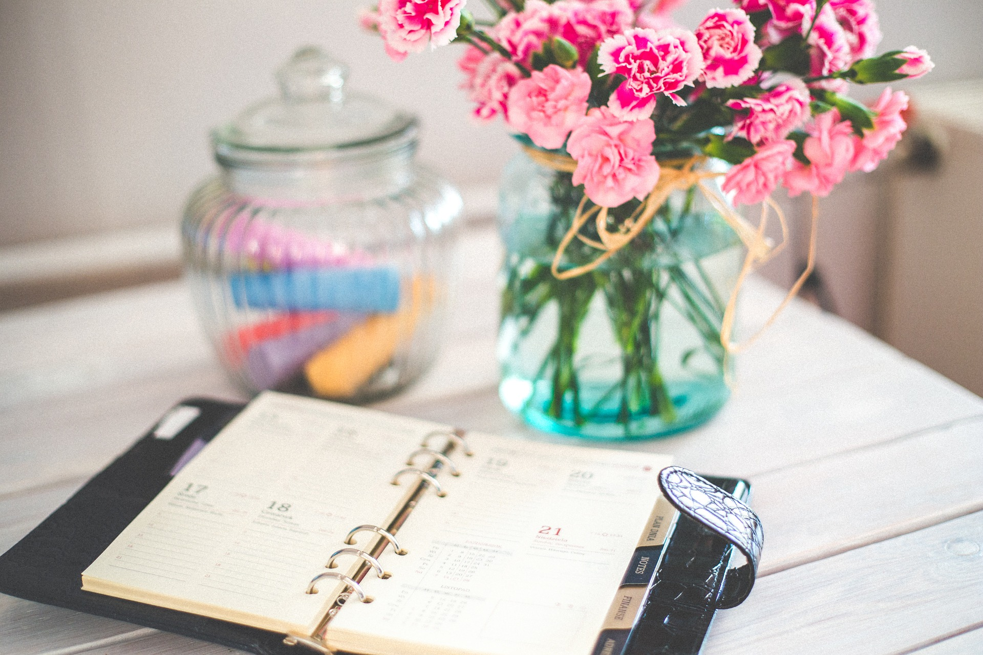 diary organizer and pink flowers